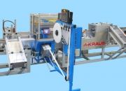 Machine for creating multipacks, integratated with banding system